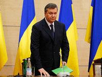 Закон, подписанный Порошенко, ограничит передвижения Януковича по миру
