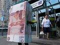 Аналитики советуют вкладывать рубли в золото и недвижимость