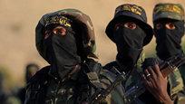 Палестинские боевики из признанной террористической во многих странах организации  Исламский джихад  приняли участие в военных учениях в Дейр-Эль-Балах в центральной части сектора Газа. Это одна из наиболее загадочных палестинских военизированных группировок, которая в своей деятельности придерживается принципов строгой конспирации, поэтому эти снимки — явная удача фоторепортера…